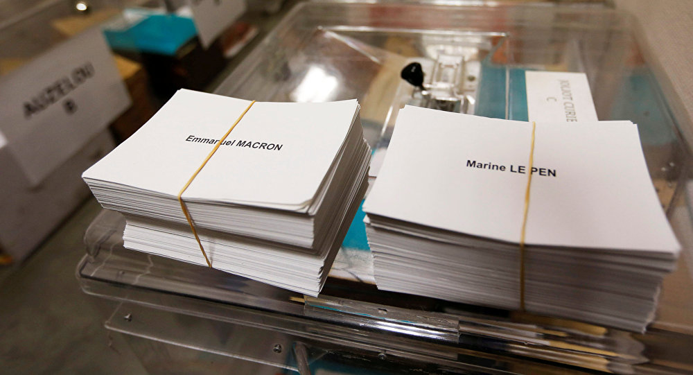Ballots with the names of 2017 French presidential election candidates Emmanuel Macron (L) and Marine Le Pen are seen near ballot boxes on the eve of the second round of the French presidential election, at a polling station in Tulle, France, May 6, 2017