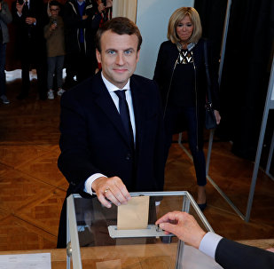 French presidential election candidate Emmanuel Macron, head of the political movement En Marche !, or Onwards ! casts his ballot at a polling station during the the second round of 2017 French presidential election, in Le Touquet, France, May 7, 2017.
