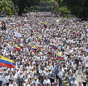 Venezuelan opposition activists take part in a women's march aimed to keep pressure on President Nicolas Maduro, whose authority is being increasingly challenged by protests and deadly unrest, in Caracas
