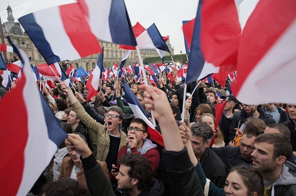 Supporters of French president-elect Emmanuel Macron react at the Louvre Museum in Paris on May 7, 2017, after the second round of the French presidential election.