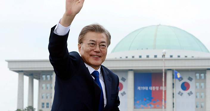 South Korean President Moon Jae-in waves as he leaves the National Cemetery after inaugural ceremony in Seoul, South Korea May 10, 2017.