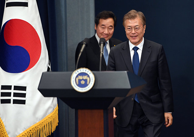 South Korea's new President Moon Jae-in (R) arrives to attend a press conference as Prime Minister nominee Lee Nak-yon follows him at the presidential Blue House in Seoul, South Korea May 10, 2017.