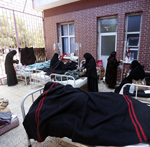 Yemenis suspected of being infected with cholera receive treatment at a hospital in Sanaa on May 6, 2017