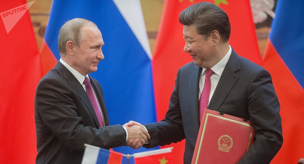 Russian President Vladimir Putin, left, and President of the People's Republic of China Xi Jinping during a signing ceremony of documents following their talks in Beijing. File photo