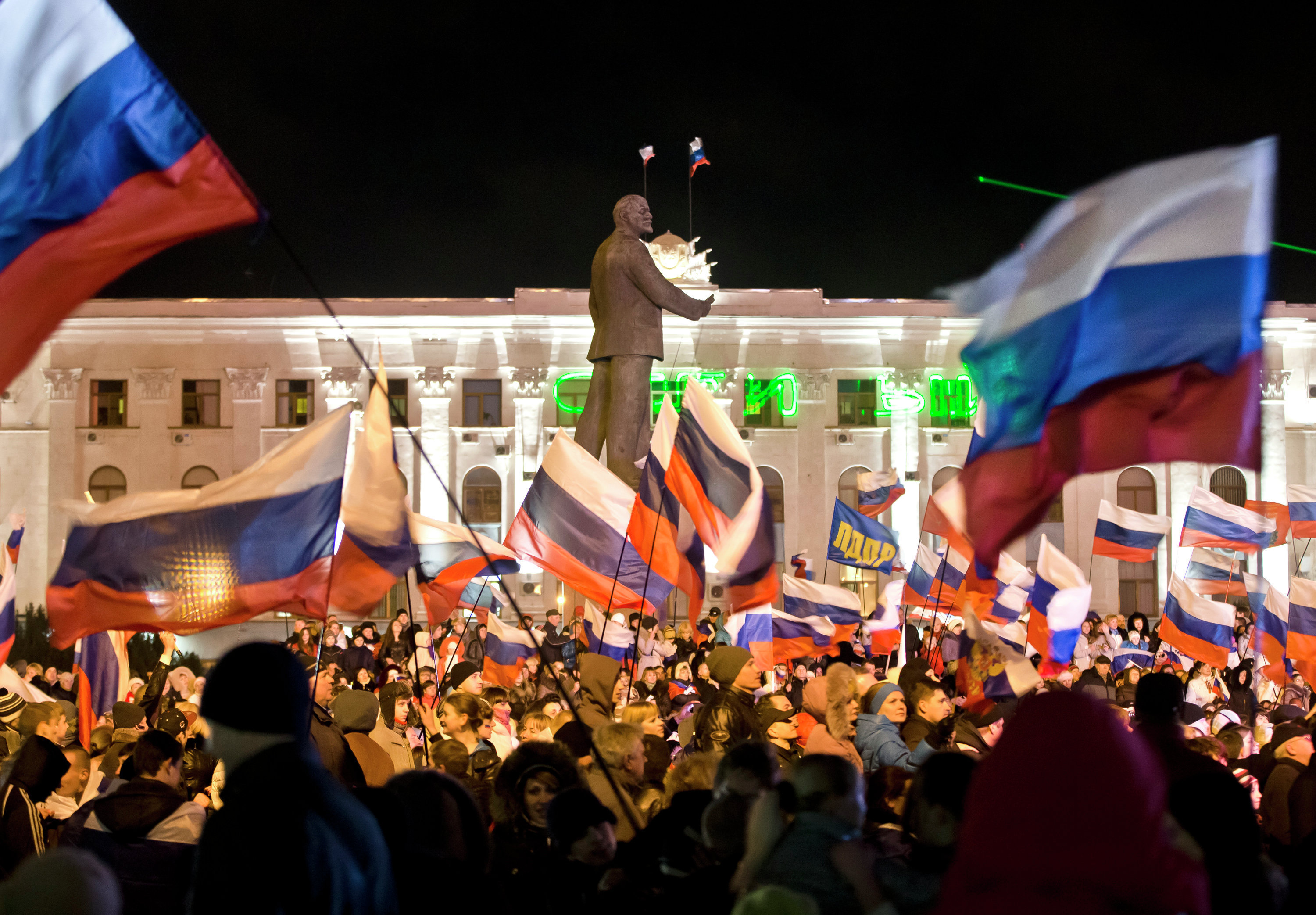 Pro-Russian people celebrate in Lenin Square, in Simferopol, Ukraine, Sunday, March 16, 2014.