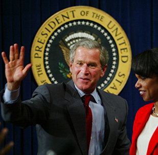 President Bush waves to urban leaders after finishing his speech at the Eisenhower Executive Office Building Tuesday, July 16, 2003 in Washington