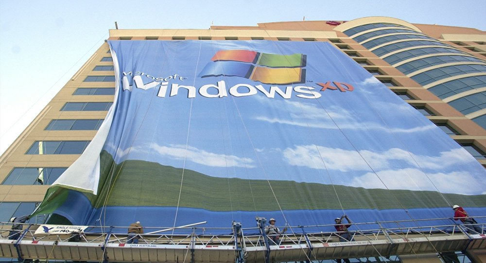In this Nov. 8 2001 file photo, workers install a 10-story Windows XP banner on a hotel near the Las Vegas Convention Center in Las Vegas