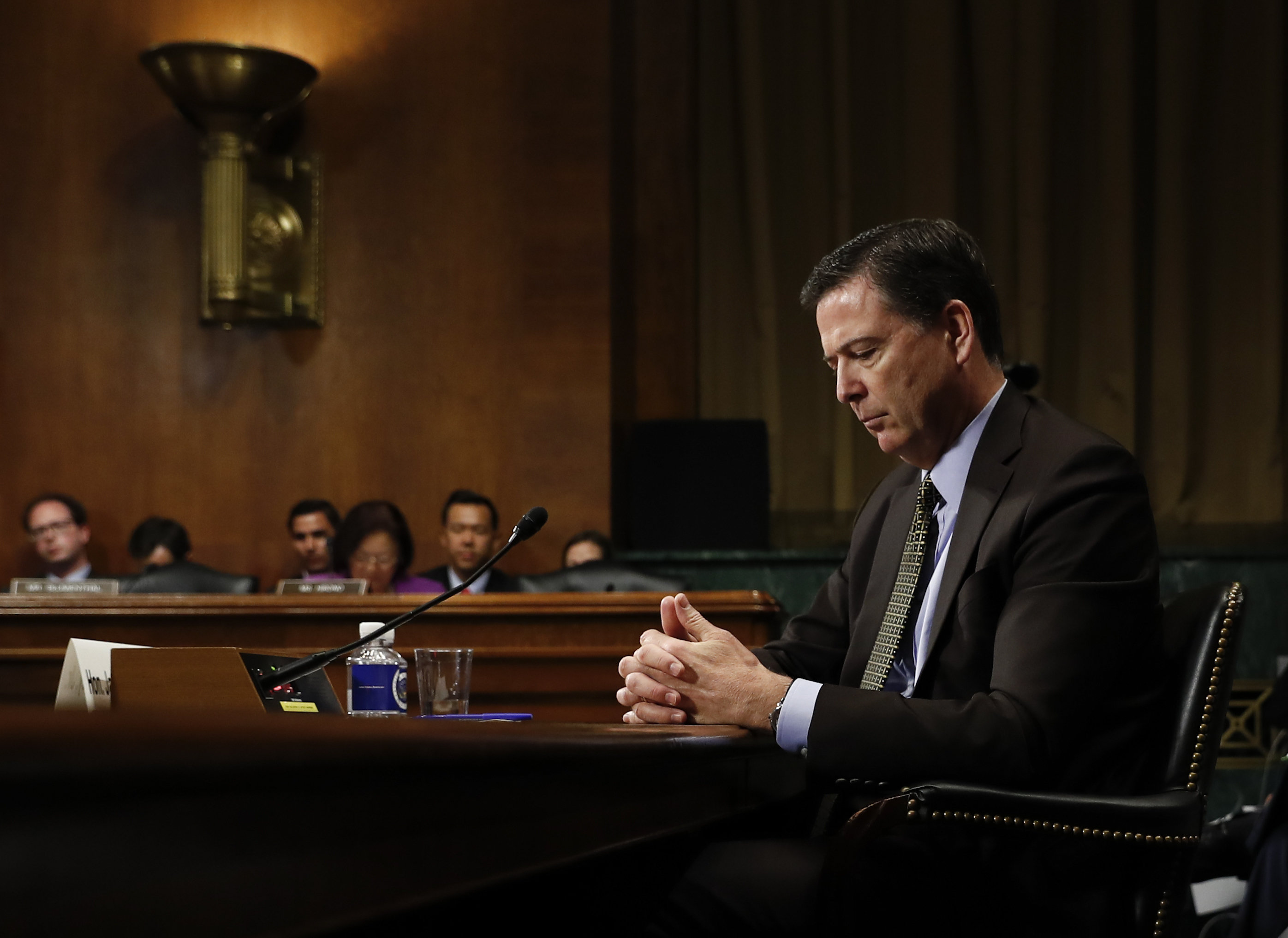In this Wednesday, May 3, 2017, photo then-FBI Director James Comey pauses as he testifies on Capitol Hill in Washington, before a Senate Judiciary Committee hearing