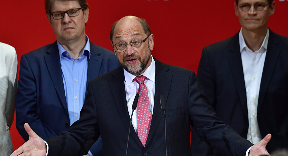 Social Democratic Party (SPD) leader Martin Schulz (C) speaks after the publication of the preliminary results of the regional elections in the West German state of North Rhine-Westphalia at the headquarters of the SPD in Berlin on May 14, 2017