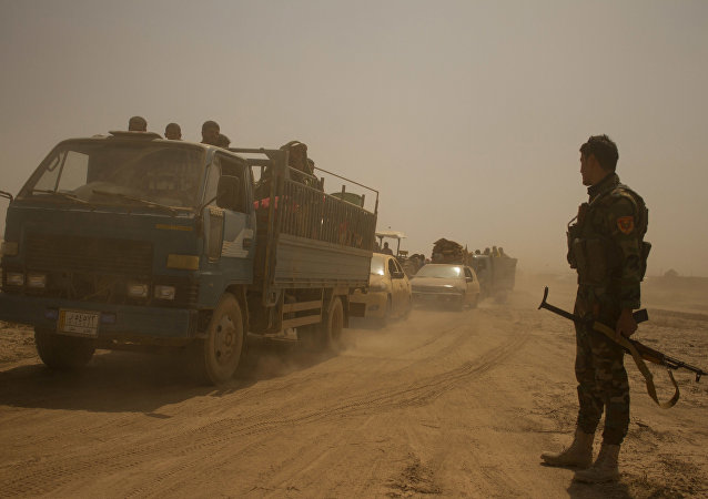 Hundreds of civilians flee villages outside Mosul the day after Iraqi Kurdish forces launch an operation east of Islamic State-held Mosul