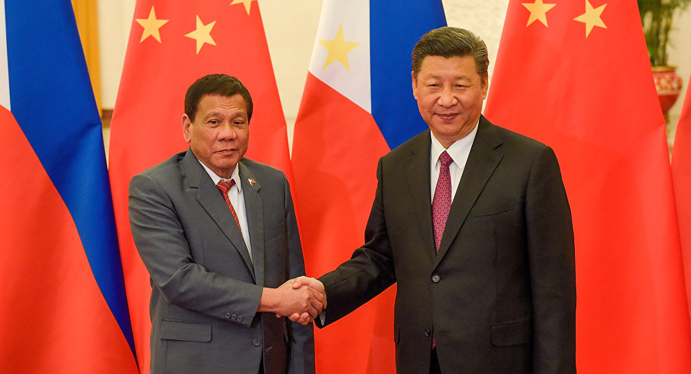 Chinese President Xi Jinping (R) shakes hands with Philippines President Rodrigo Duterte prior to their bilateral meeting during the Belt and Road Forum, at the Great Hall of the People in Beijing, China May 15, 2017.