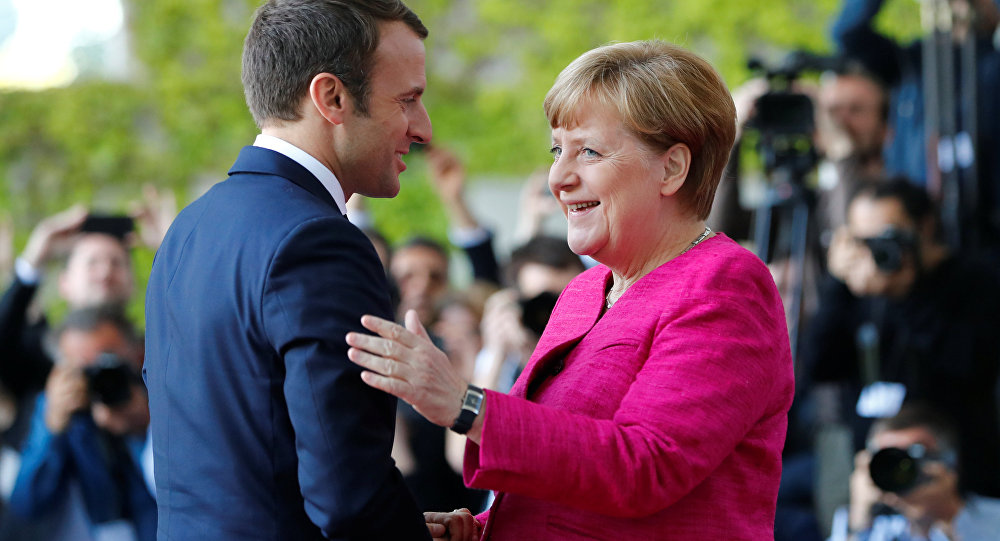 German Chancellor Angela Merkel welcomes French President Emmanuel Macron as they arrive at a ceremony at the Chancellery in Berlin, Germany, May 15, 2017.
