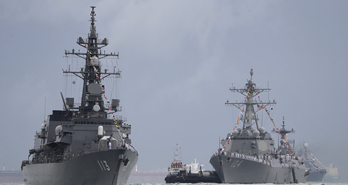 Japan's destroyer JS Sazanami, left, the United State's Arleigh Burke-class guided missile destroyer USS Sterett, center, and South Korean destroyer ROKS Dae Jo Yeong, right rear.