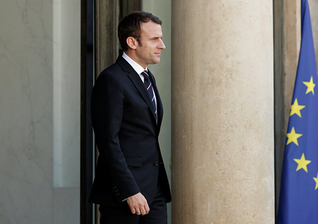 French President Emmanuel Macron waits for a guest on the steps at the Elysee Palace in Paris, France, May 16, 2017.