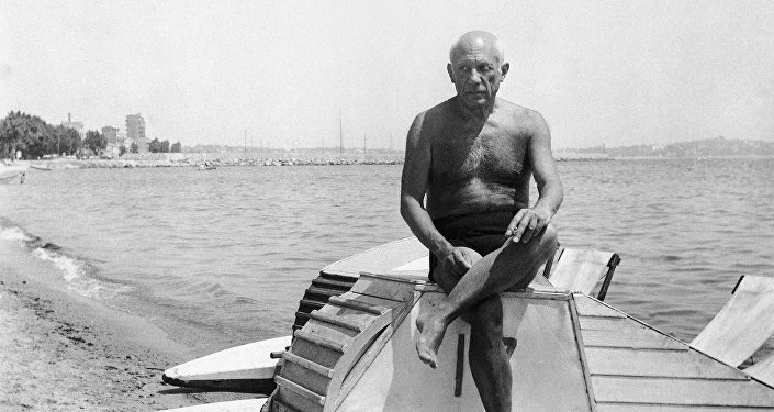 Pablo Picasso suns himself on a boat on the beach at Golfe Juan in Vallauris on the French Riviera on March 10, 1948.