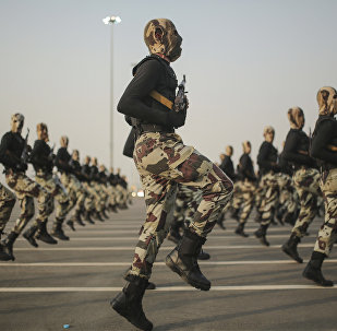 In this Sept. 17, 2015 file photo, Saudi security forces take part in a military parade in preparation for the annual Hajj pilgrimage in Mecca, Saudi Arabia.
