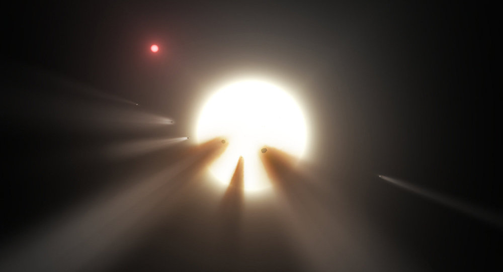 This illustration shows a star behind a shattered comet. Observations of the star KIC 8462852 by NASA's Kepler and Spitzer space telescopes suggest that its unusual light signals are likely from dusty comet fragments, which blocked the light of the star as they passed in front of it in 2011 and 2013