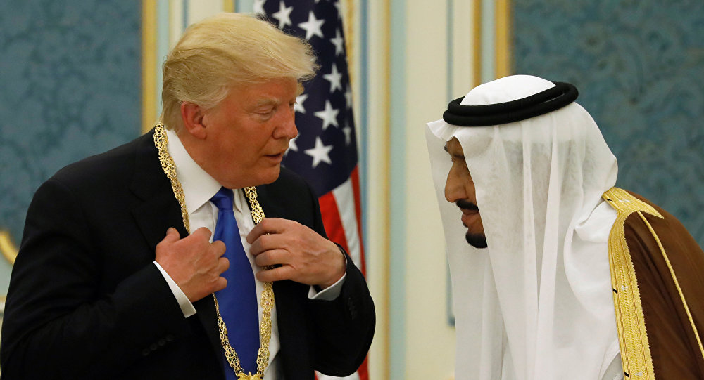 Saudi Arabia's King Salman bin Abdulaziz Al Saud (R) presents U.S. President Donald Trump with the Collar of Abdulaziz Al Saud Medal at the Royal Court in Riyadh, Saudi Arabia May 20, 2017