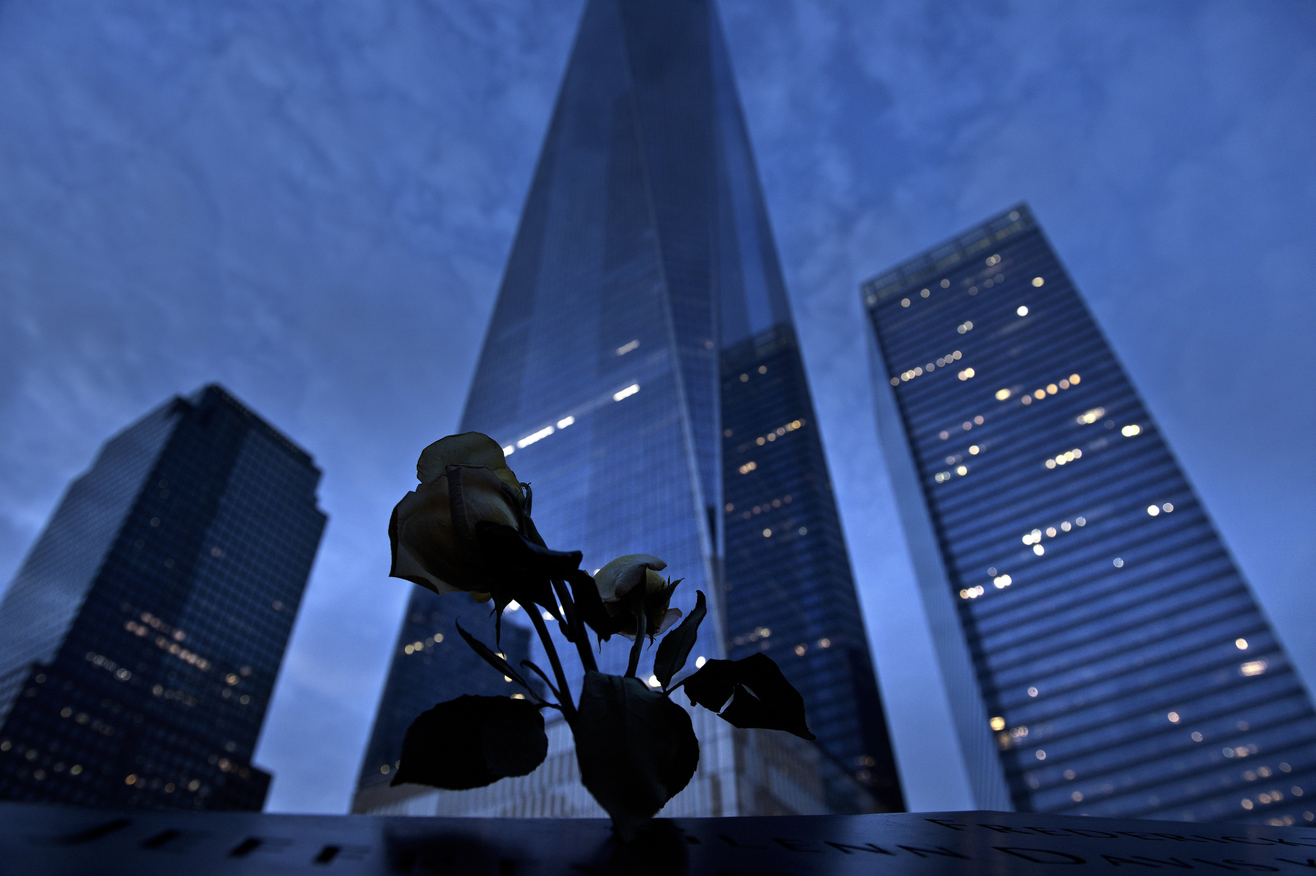 A view of One World Trade Center from the North Pool, which marks the former site of the North Tower of the World Trade Center, at Ground Zero the night before the 15th anniversary of the September 11, 2001 terrorist attacks in the United States in New York
