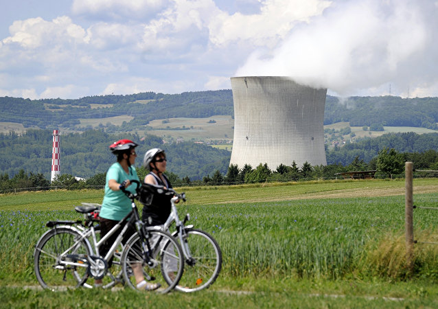 his file photo taken on May 22, 2011 shows two women walking in front of Leibstadt nuclear power plant near Leibstadt, northern Switzerland