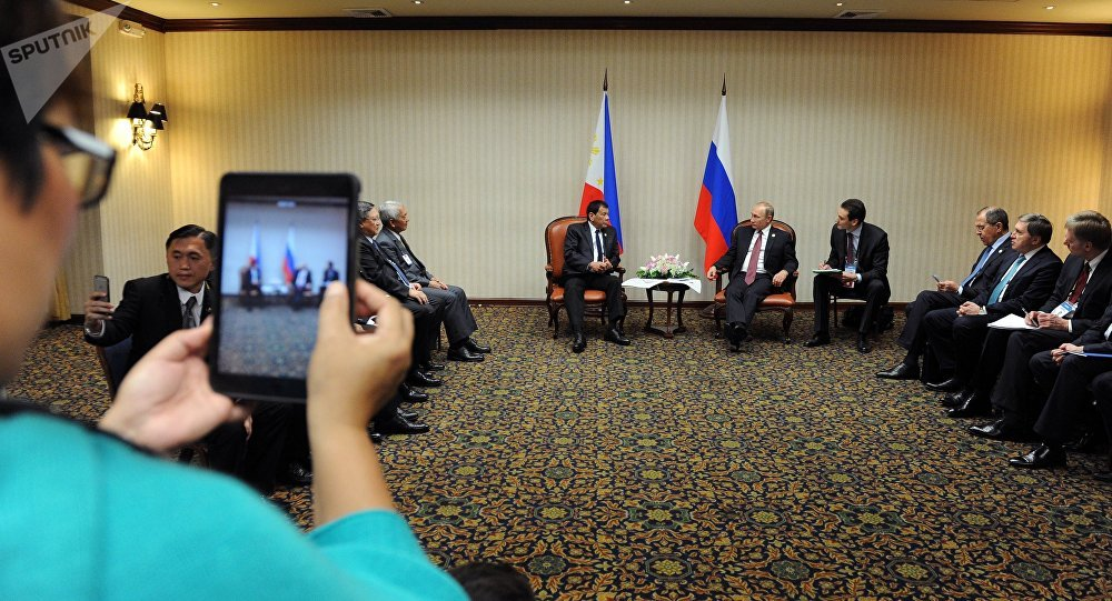 November 19, 2016. Russian President Vladimir Putin and Philippine President Rodrigo Duterte, background left, during a meeting on the sidelines of the APEC summit in Lima