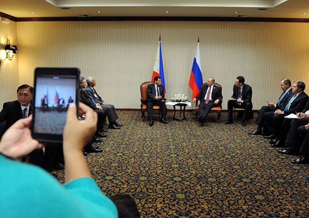 Russian President Vladimir Putin and Philippine President Rodrigo Duterte, background left, during a meeting on the sidelines of the APEC summit in Lima on November 19, 2016