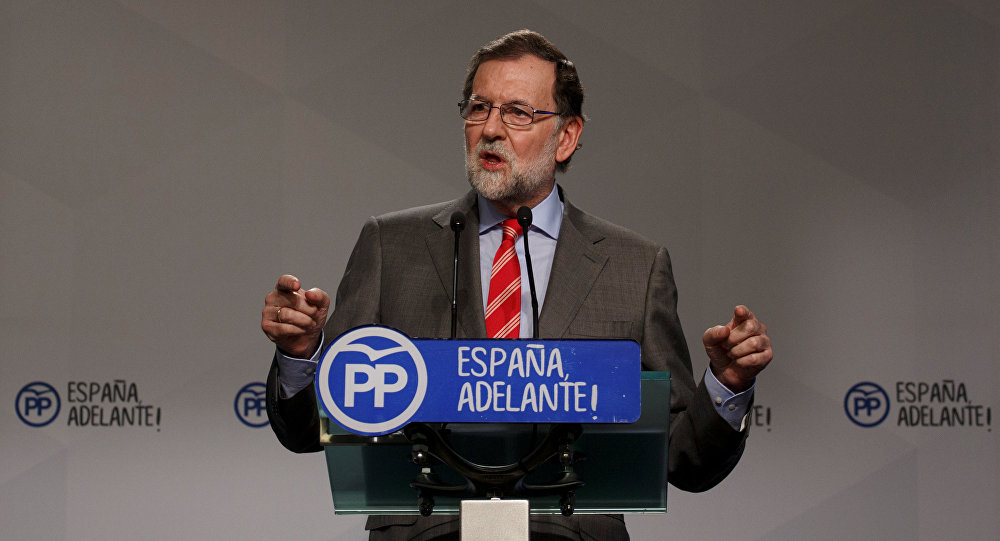 Spain PM accuses Catalan leader of blackmail