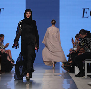 Models walk down the catwalk wearing designs by Zoe Eckett during the Arab Fashion Week in the United Arab Emirate of Dubai on May 18, 2017