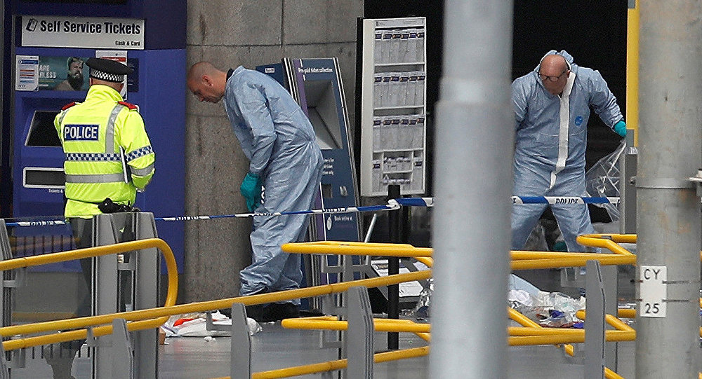 Forensics investigators work at the Manchester Arena in Manchester, Britain