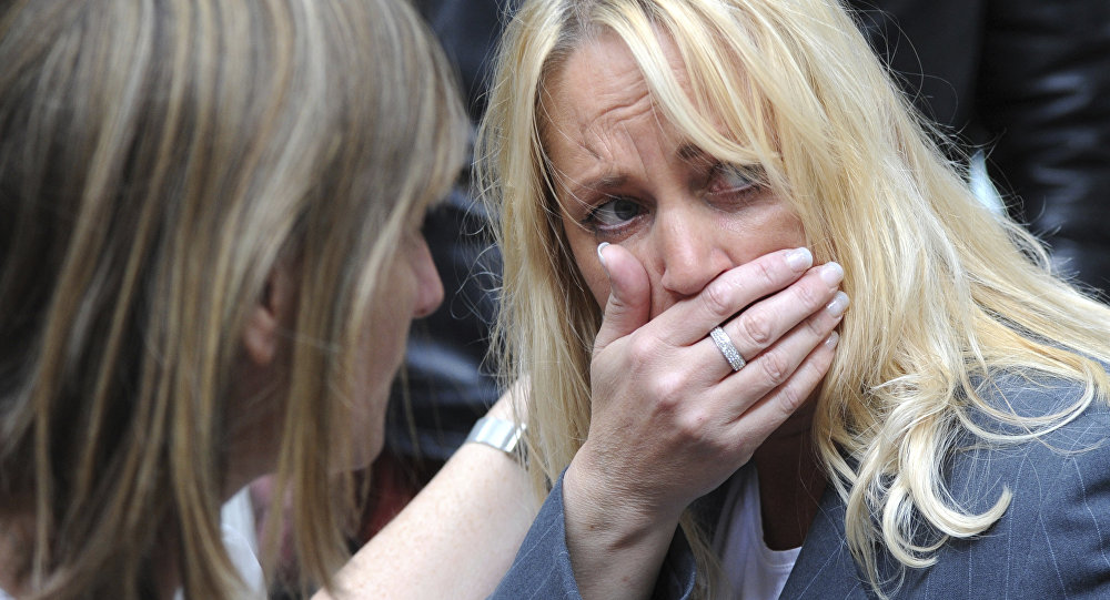 A member of the public reacts as police evacuate the Arndale shopping centre, in Manchester, England Tuesday May 23, 2017, the day after an apparent suicide bomber attacked an Ariana Grande concert as it ended Monday night, killing over a dozen of people among a panicked crowd of young concertgoers.