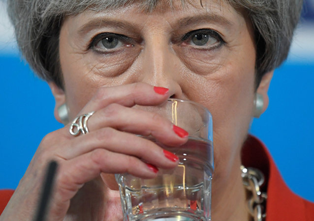 Britain's Prime Minister Theresa May sips water as she speaks at an election campaign event in Wrexham, Wales May 22, 2017.