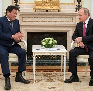 President Vladimir Putin at a meeting with President of the Philippines Rodrigo Duterte, left