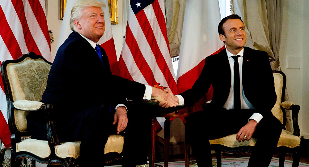 U.S. President Donald Trump (L) shakes hands with French President Emmanuel Macron before a working lunch ahead of a NATO Summit in Brussels, Belgium, May 25, 2017.