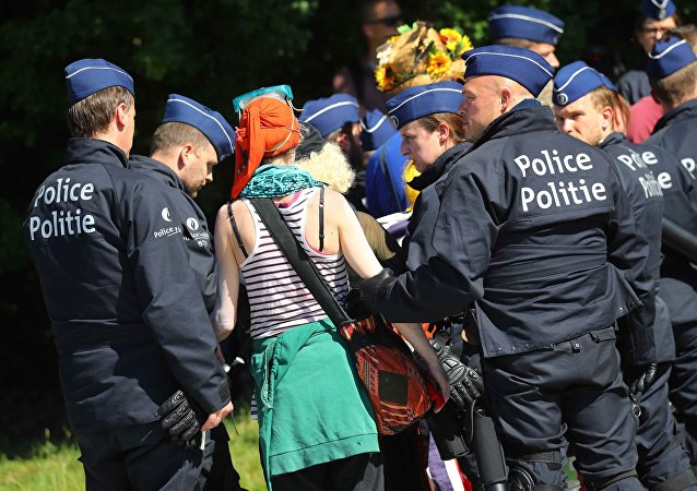 Demonstrators are led away by police during a protest against a NATO summit in Brussels, Belgium