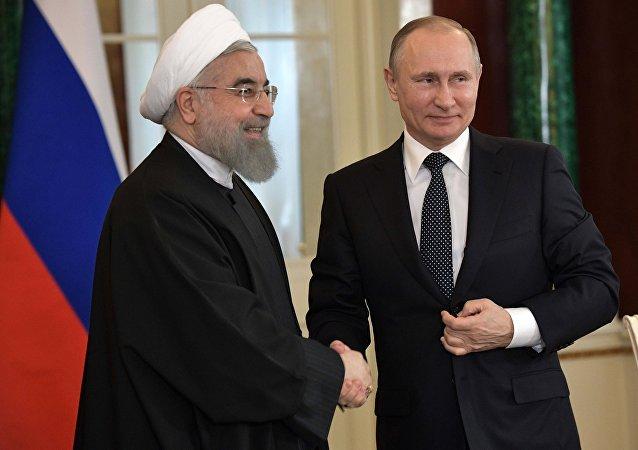 Vladimir Putin meets with Iranian President Hassan Rouhani
