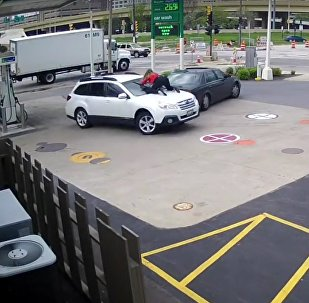 Dramatic moment woman jumps onto hood of SUV to stop carjackers