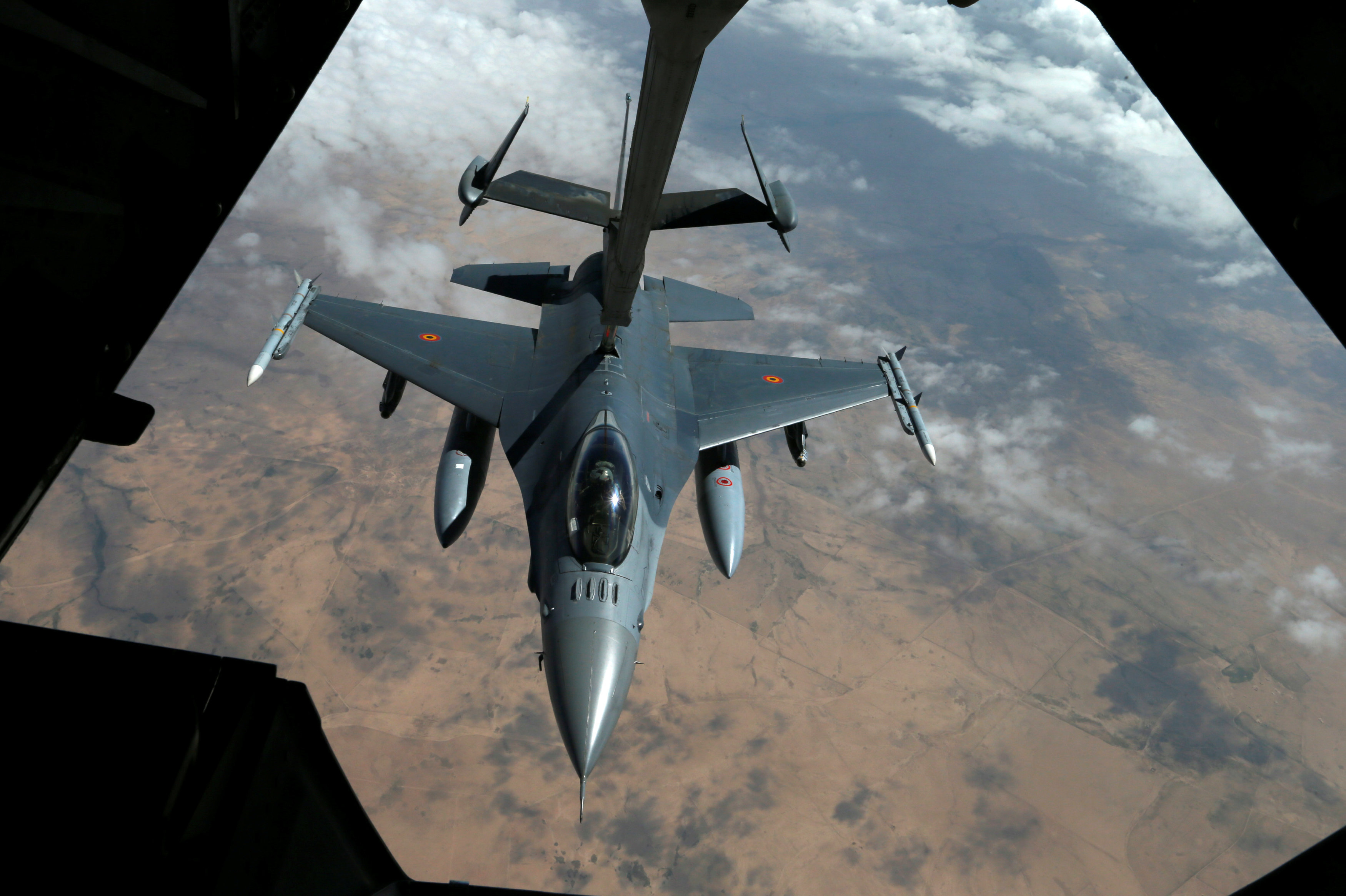 A Belgian Air Force F-16 receives fuel from a fuel boom suspended from a US Air Force KC-10 Extender during mid-air refueling support to Operation Inherent Resolve over Iraq and Syria air space, March 15, 2017