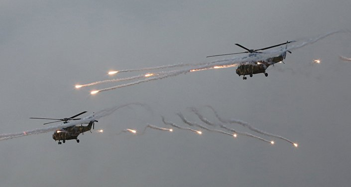 South Korean army Surion helicopters fire flares during a South Korea-U.S. joint military live-fire drills at Seungjin Fire Training Field in Pocheon, South Korea,