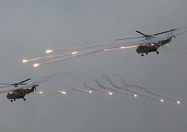 South Korean army Surion helicopters fire flares during a South Korea-US joint military drills.