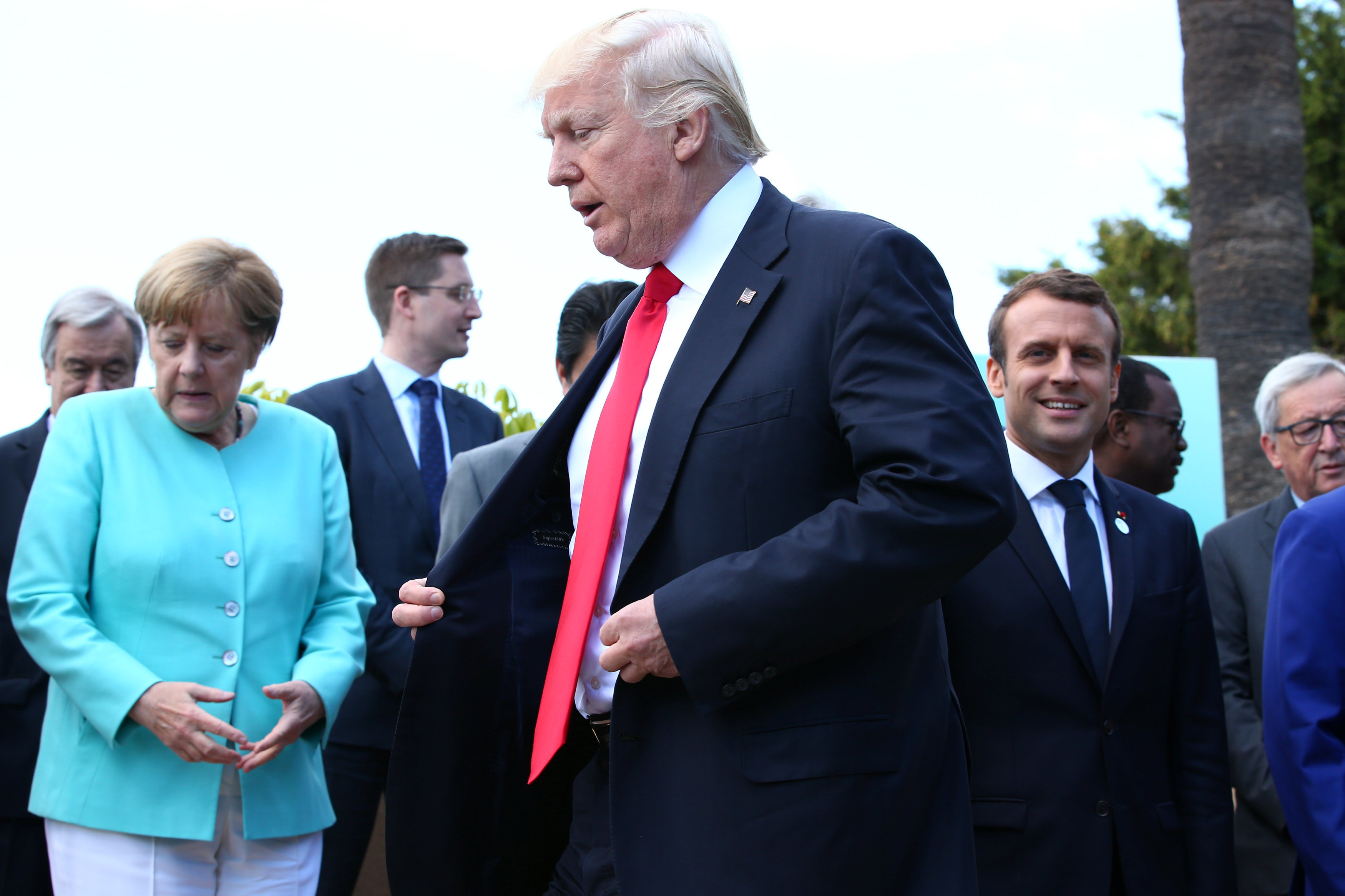German Chancellor Angela Merkel, U.S. President Donald Trump and French President Emmanuel Macron during a family photo at the G7 Summit expanded session in Taormina, Sicily, Italy, May 27, 2017