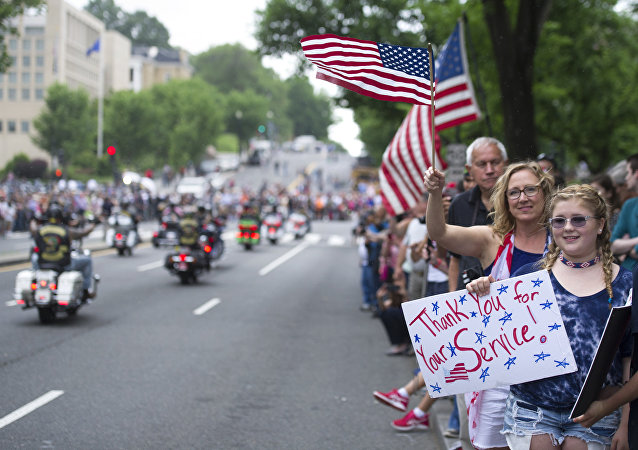 Supporters line the street as motorcyclists participate in the 30th anniversary of the Rolling Thunder 'Ride for Freedom' demonstration in Washington, Sunday, May 28, 2017