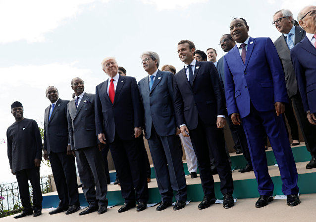 L-R Front Row: Nigeria's Vice-President Yemi Osinbajo, Kenya's President Uhuru Kenyatta, Guinea's President Alpha Conde, U.S. President Donald Trump, Italian Prime Minister Paolo Gentiloni, French President Emmanuel Macron, Niger's President Mahamadou Issoufou and Tunisian President Beji Caid Essebsi pose for a family photo with other participants of the G7 Summit expanded session in Taormina, Sicily, Italy May 27, 2017