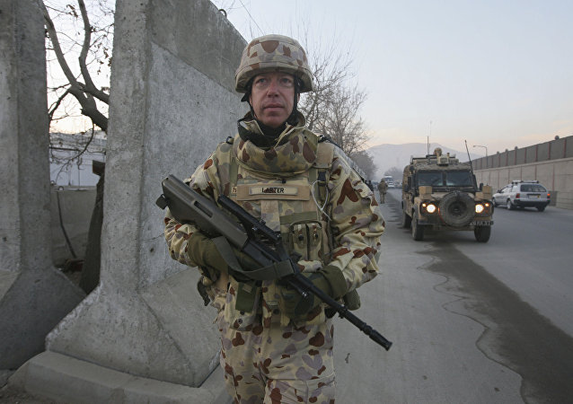 An Australian soldier Mark Larter with the International Security Assistant Force walks during a patrolling on Christmas day in Kabul, Afghanistan, on Thursday, Dec. 25, 2008
