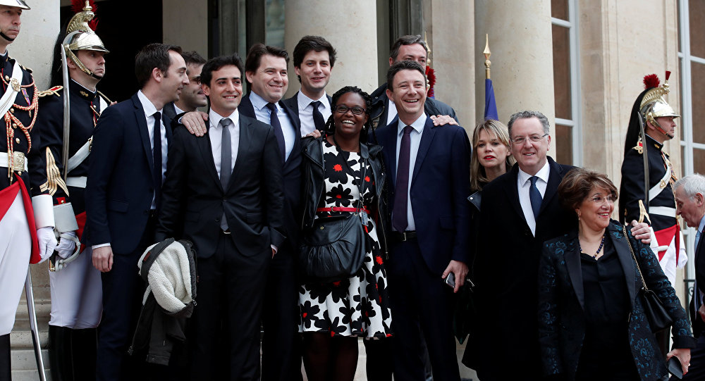 Emmanuel Macron's close team of the party's La Republique en marche (Republic on move) : Sibeth Ndiaye (C), Head of the public relations of the party, spokesman Benjamin Griveaux (C-R), Richard Ferrand, Julien Denormandie (4thL), Stephane Sejourne (2thL), Jean-Marie Girier (L), Sylvain Fort (3rdL) pose at the Elysee Palace prior to the handover ceremony for new French President Emmanuel Macron (unseen), in Paris, France, 14 May 2017