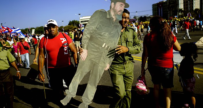 A soldier carries a life-size cut out of Cuba's late leader Fidel Castro during the May Day parade at Revolution Square in Havana, Cuba, Monday, May 1, 2017.