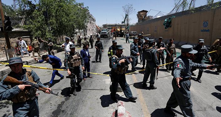 Afghan policemen inspect at the site of a blast in Kabul, Afghanistan May 31, 2017