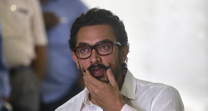 Bollywood actor Aamir Khan speaks to media on his 52th birthday in Mumbai, India, Tuesday, March 14, 2017.