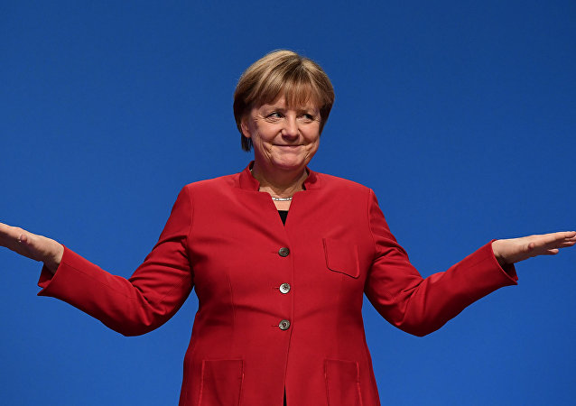 German Chancellor Angela Merkel gestures after addressing delegates during her conservative Christian Democratic Union (CDU) party's congress in Essen, western Germany.