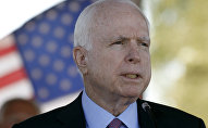 In this May 30, 2016, photo, Sen. John McCain, R-Ariz, speaks during a Phoenix Memorial Day Ceremony at the National Memorial Cemetery of Arizona in Phoenix.