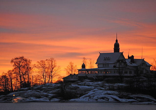 The sun sets over an island in the Helsinki archipelago